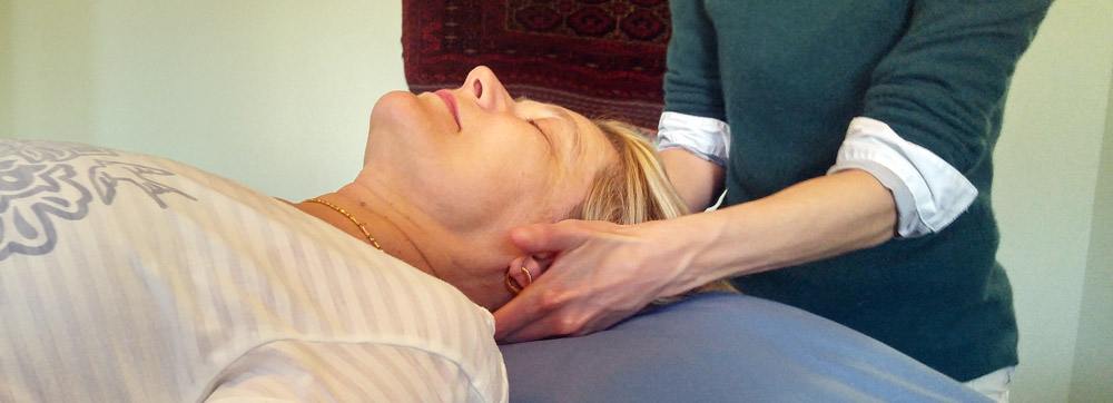 Therapist connects to the spine and head and cranial bones to provide treatment.